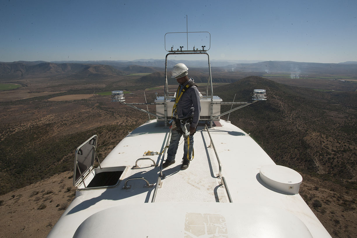 working on the top of a wind tower in South Afruca