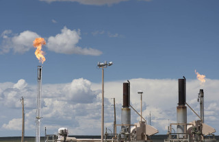 "At a collection area, gas is pumped in from fractured wells in northern New Mexico, here some of the VOC compounds are burnt in plumes of fire.  The Four Corners Area of New Mexico, Colorado, Utah and Arizona has the biggest methane hot spot in the United States, and can be seen from space.  Methane is 40 times more powerful a greenhouse gas than Carbon Dioxide.  Hydraulic fracturing has created America's energy boom, but it has also created major environmental problems that are only now being fully researched and understood. Throughout the country ""fracking"" has local communities up in arms over highly dangerous airborn pollutants, and reasearchers from NASA, The National Oceanic and Atmospheric Assosciation (NOAA) and the University of Colorado are confirming that massive amounts of Methane and other Volatile Organic Compounds (VOCs) are being released at levels between 2 and 5 times higher than Environmental Protection Agency estimates."